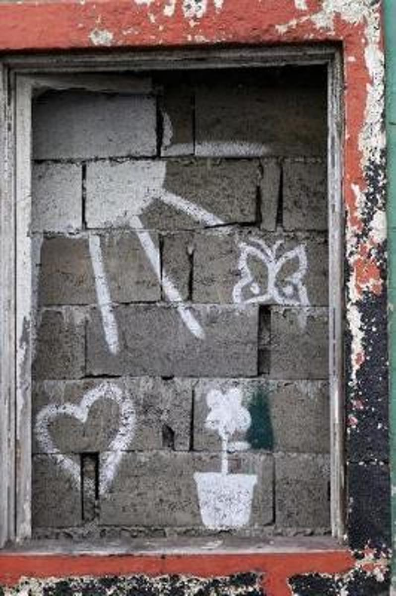 Graffiti on a Bricked Up Window and Wall Street Art Journal