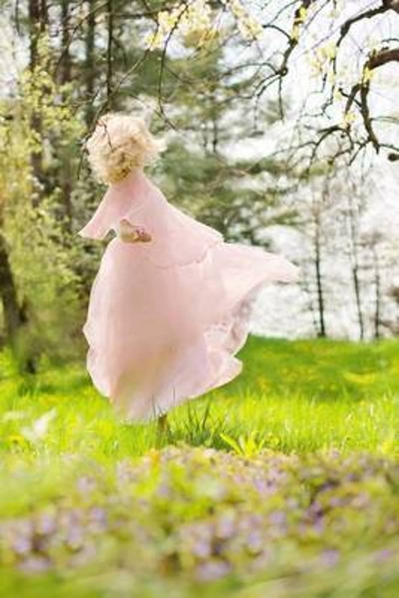 Sweet Girl in a Pink Dress Twirling Around in a Meadow Journal